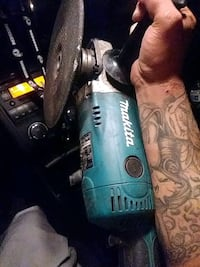 blue and black Makita angle grinder 2225 mi