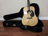 brown acoustic guitar with hard case MONTREAL