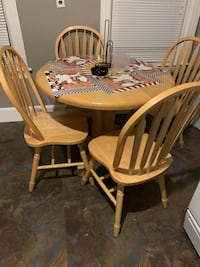 oval brown wooden table with four chairs dining set Providence, 02904
