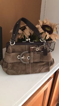 Authentic Coach  brown suede clutch purse. Used and in excellent condition. Germantown, 20874