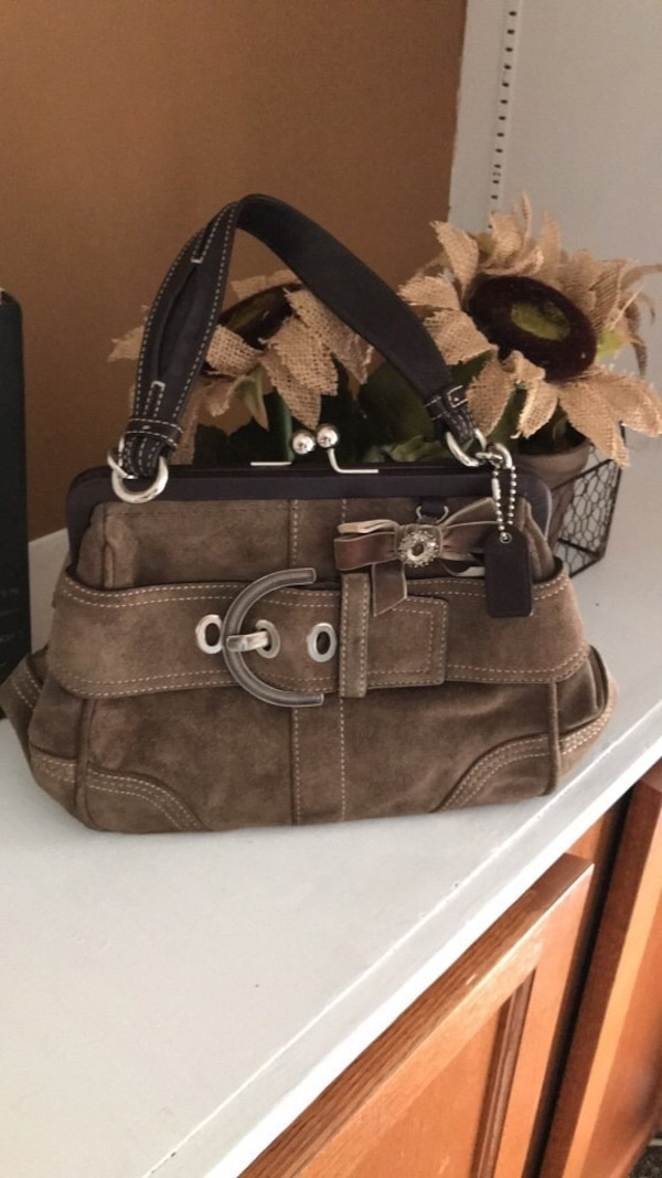 Authentic Coach  brown suede clutch purse. Used and in excellent condition.