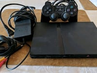black Sony PS2 Slim with two controllers Queens, 11435