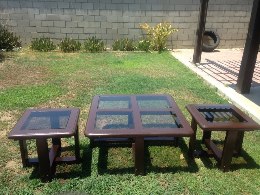 three square brown wooden framed glass tables