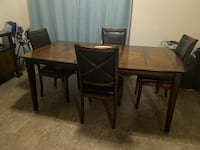 Dark brown dining table, with servers table