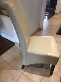 8 ivory chairs faux leather