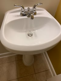 Pedestal Sink and Designer Faucet