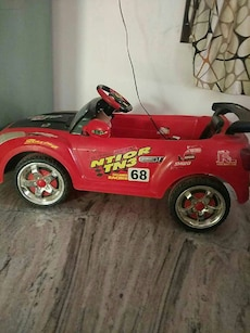 toddler's red and black Ntior TN3 ride on toy