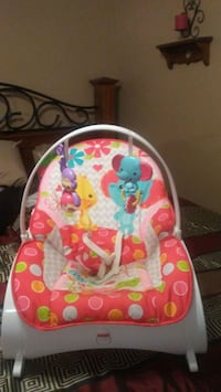 baby's pink and white bouncer 669 mi