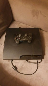 black Sony PS3 slim console with controller Arlington, 22207