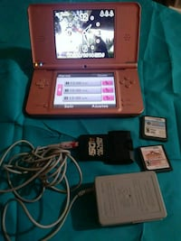 red Nintendo DS with game cartridges McAllen, 78501