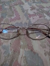 silver-framed eyeglasses Houston, 77006