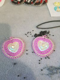 pair of pink and silver earrings