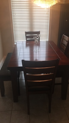brown wooden 4 chair and 1 table dining set