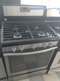 stainless steel and black 5-burner gas stove range