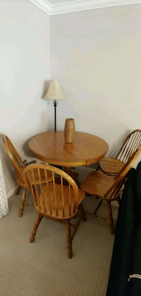 oval brown wooden table with four chairs dining set Surrey, V3S 2P6