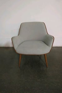 Light grey lounge chair with wood trim 554 km