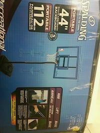 """44"""" blue and black Spalding portable basketball system box"""
