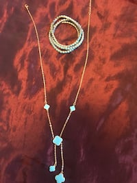 silver-colored necklace with blue gemstone pendant Vancouver, V5P 2R6