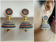 white, red and blue studded jhumkas