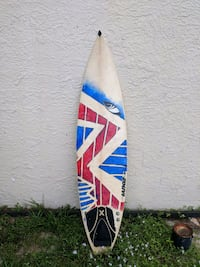 white, blue, and yellow surfboard 774 mi