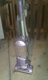 gray and purple Shark upright vacuum cleaner