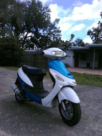 blue and white motor scooter Orlando, 32803