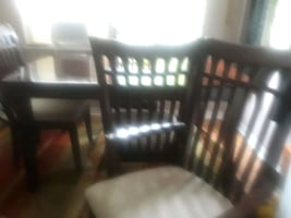 Dining room table with four chairs...2 arm, 2 side. Very good shape.