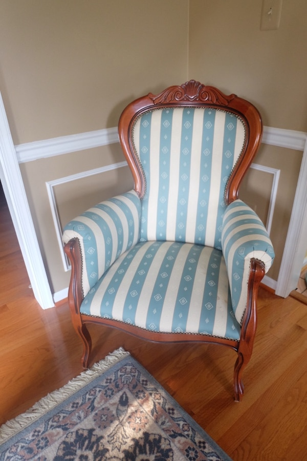 white and blue striped padded armchair