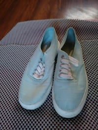 pair of teal-and-white low-top sneakers