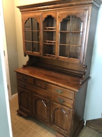 brown wooden cabinet with hutch null