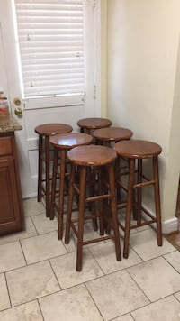 Six brown wooden bar stools Baltimore, 21215