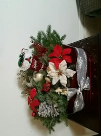 white, red, and green floral wreath 498 km