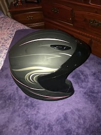 Women's size small motorcycle helmet in mint condition only 75.00$ obo