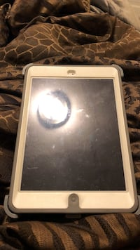 White ipad with grey and white case