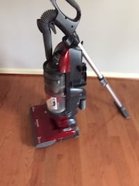 80% new Panasonic  Black and red upright vacuum cleaner Herndon, 20171