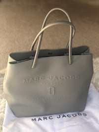 Marc Jacobs logo tote bag available.