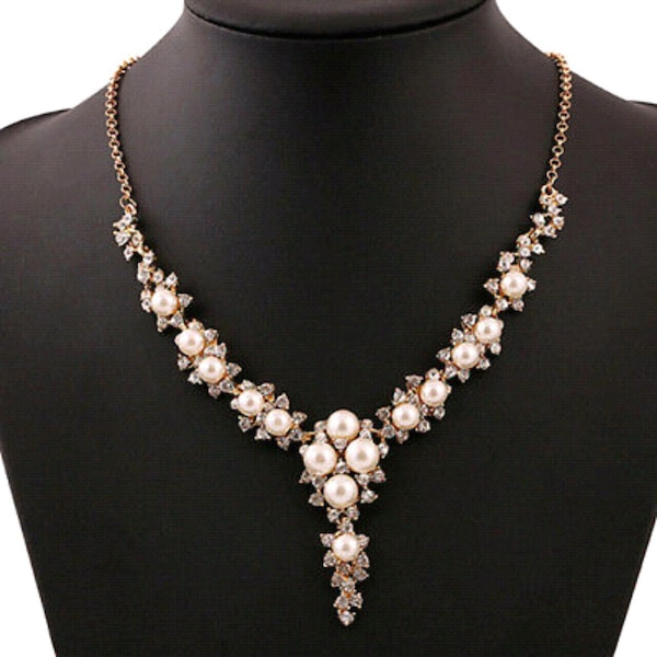 silver-colored necklace with clear gemstones