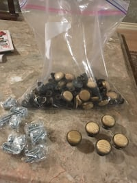 54 cabinet knobs with brand new screws  St Catharines, L2W 1B2