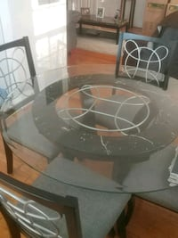 round clear glass top table with four chairs dining set Arlington, 22204