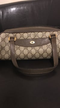 brown and black Gucci leather crossbody bag
