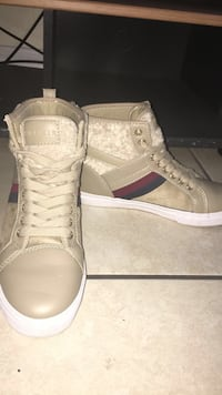 pair of white high-top sneakers Winter Park, 32792