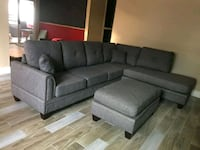 Brand new!! Gray reversible Sectional w/ Ottoman
