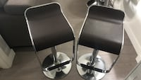 two stainless steel base with black leather padded bar stools Langley, V3A 0E6