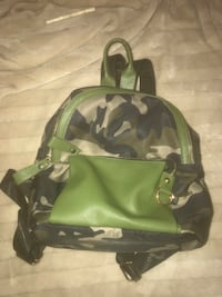 green and black camouflage backpack 59 km