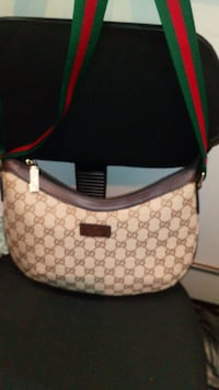 monogrammed white and brown Gucci leather bag