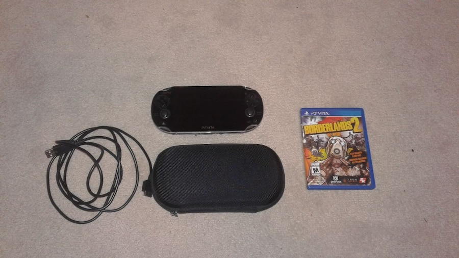 black Sony PSVITA console with case and game case, used for sale  Pickering