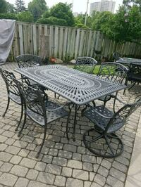 Cast iron table and 6 chairs. Two swivel and 4 reg Mississauga, L5A 1R2