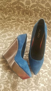 pair of blue suede pointed-toe heeled shoes
