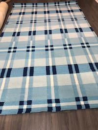 white, black, and gray plaid textile Mississauga