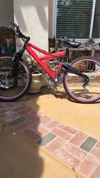 red and black full-suspension bike